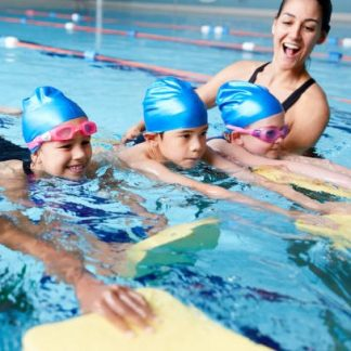 Group Of Children Swim Lessons